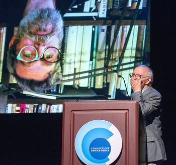 """Presenter Michael Yeargan reaction g to a video clip oops from Fabio Toblini, winning for outstanding costumes for Hartford Stage's """"The Comedy of Errors"""""""