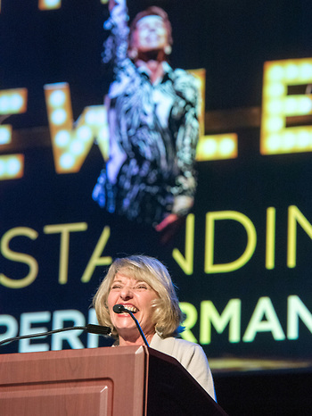 """Semina DeLaurentis accepts on behalf of Jon Peterson for outstanding solo performer in """"He Wrote Good Songs"""" at Seven Angels Theatre."""
