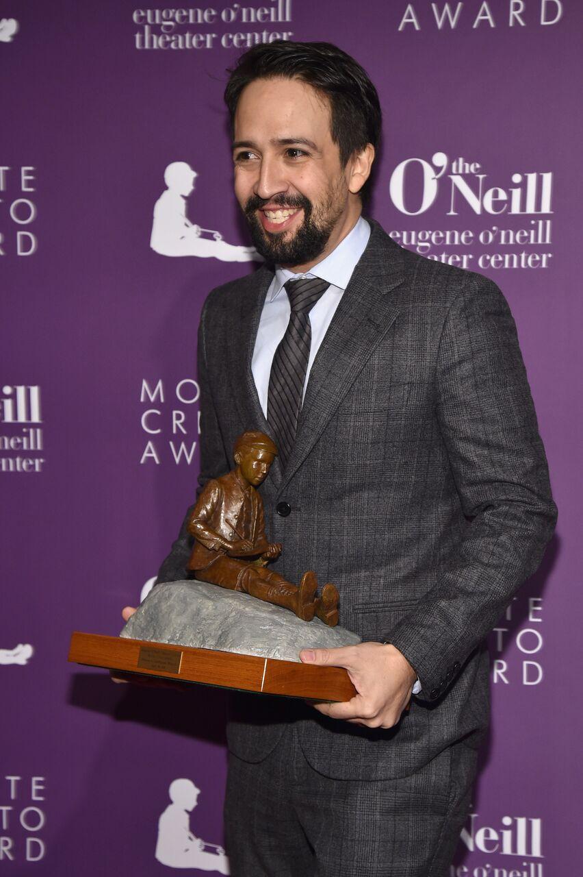 Lin Manuel Miranda and award.jpg