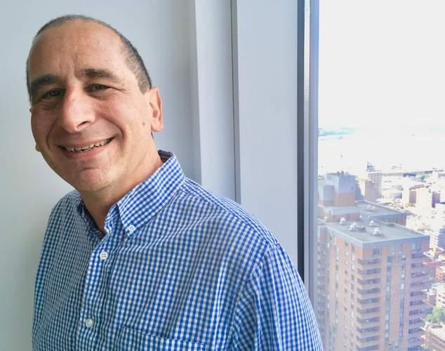 Mike Reiss SL Blue Shirt.jpg