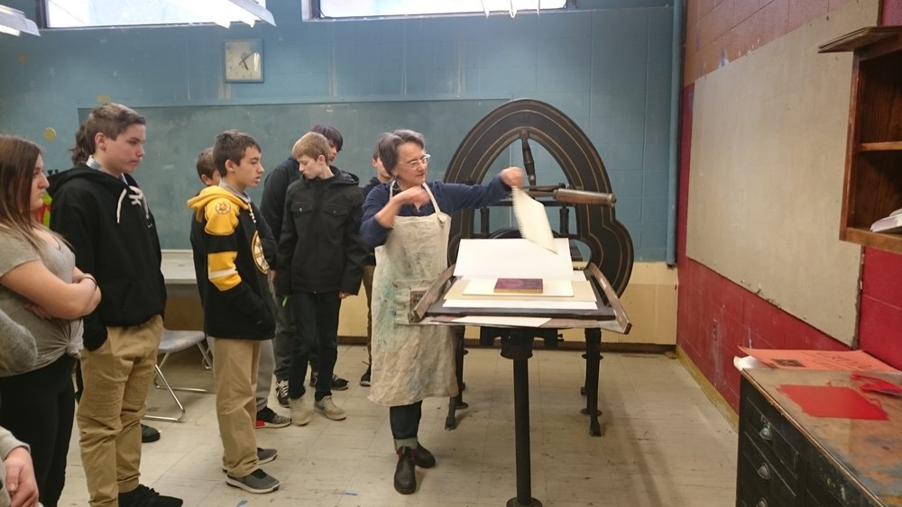 Fine Art Printer Mary Rhinelander showing O'Maley students how to pull a print off the #AcornPress. Photo Credit: Brett Dunton, O'Maley School Art Teacher