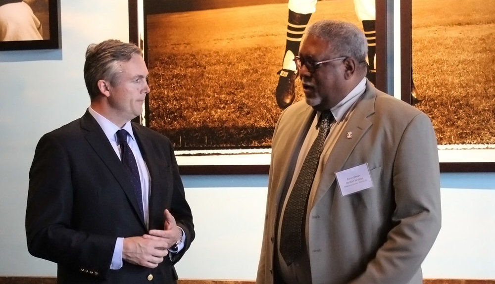 GPCC President Matt Smith speaks with Allegheny County Councilman DeWitt Walton at the Roberto Clemente Museum in Lawrenceville.