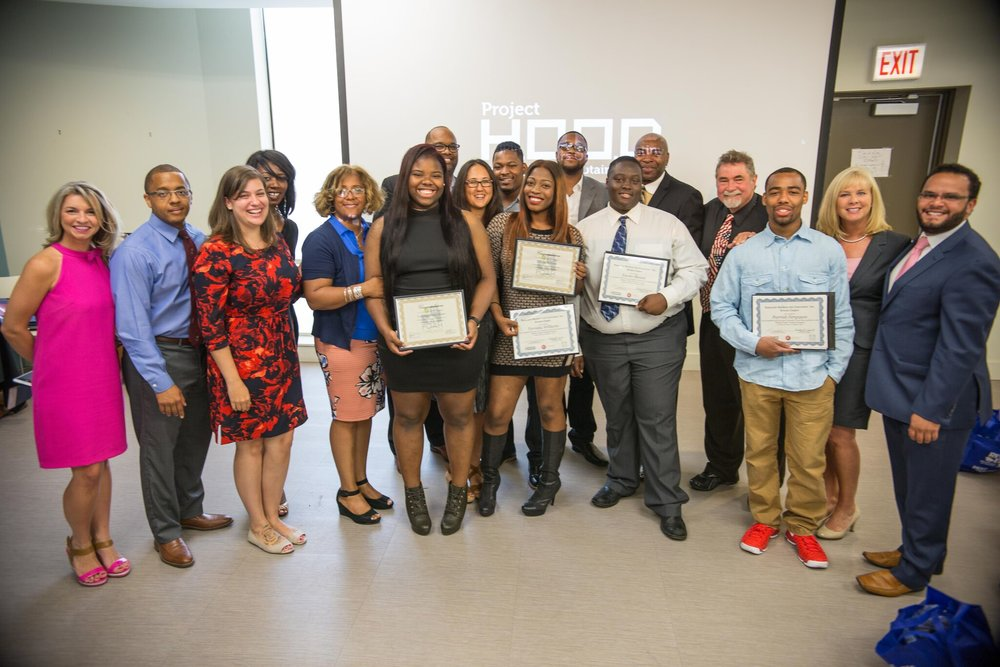 (l-r) Brittany Dowell, ABC-IL, Gregory Garland, Project H.O.O.D., Molly Moriarity, ABC-IL, Sheryl Morris, POAH/Woodlawn Resource Center, Scarlette Jones - POAH, Woodlawn Resource Center, Tunpanga Finley-Hines, graduate, Executive Director Corey B. Brooks, Project H.O.O.D., Kristen Jaciw, Project H.O.O.D., Calvin Lindsey, graduate, Terrisha Williams, graduate, Christian Cage, graduate, Xavier Blount, graduate, Manny Cunningham, ABC-IL, Steve Foltin, ABC-IL, Parrish Ferguson, graduate, Alicia Martin, ABC-IL, Manny Rodriguez, ABC-IL