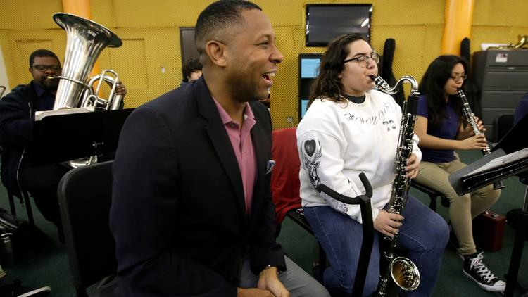 Tony Brown, the executive director of the nonprofit Heart of Los Angeles program, visits young orchestra students on the HOLA campus in Los Angeles. (Glenn Koenig / Los Angeles Times)