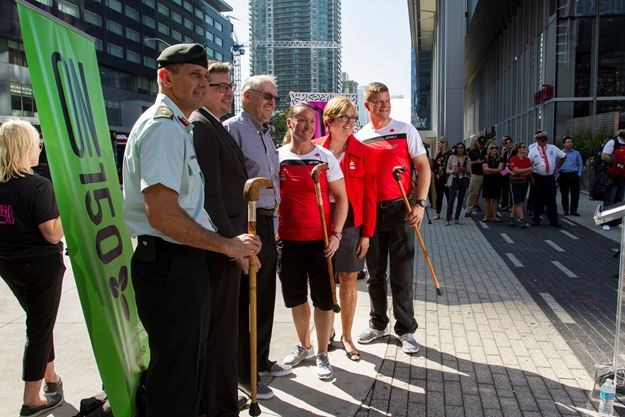 From left, Chef de Mission and Brig.-Gen. Mark Misener, Robert Steven, Art Gallery Burlington CEO, Ken Maitland, member of Burlington Sculptor and Woodcarves Guild, Team Canada co-captain Retired Master Cpl. Natacha Dupuis, Burlington MPP and Minister of Tourism, Culture and Sport Eleanor McMahon, and Team co-captain Maj. Simon Mailloux at the official welcoming of Team Canada to the 2017 Invictus Games at Maple Leaf Square in Toronto on Sept. 21 where Canes for Veterans were also presented. - Michelle Cochrane photo