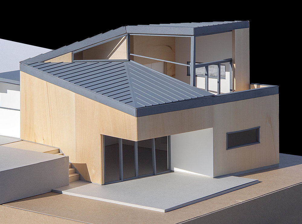 View showing the addition, which was conceived as a separate, but connected building that complements the existing house with open spaces to gather.