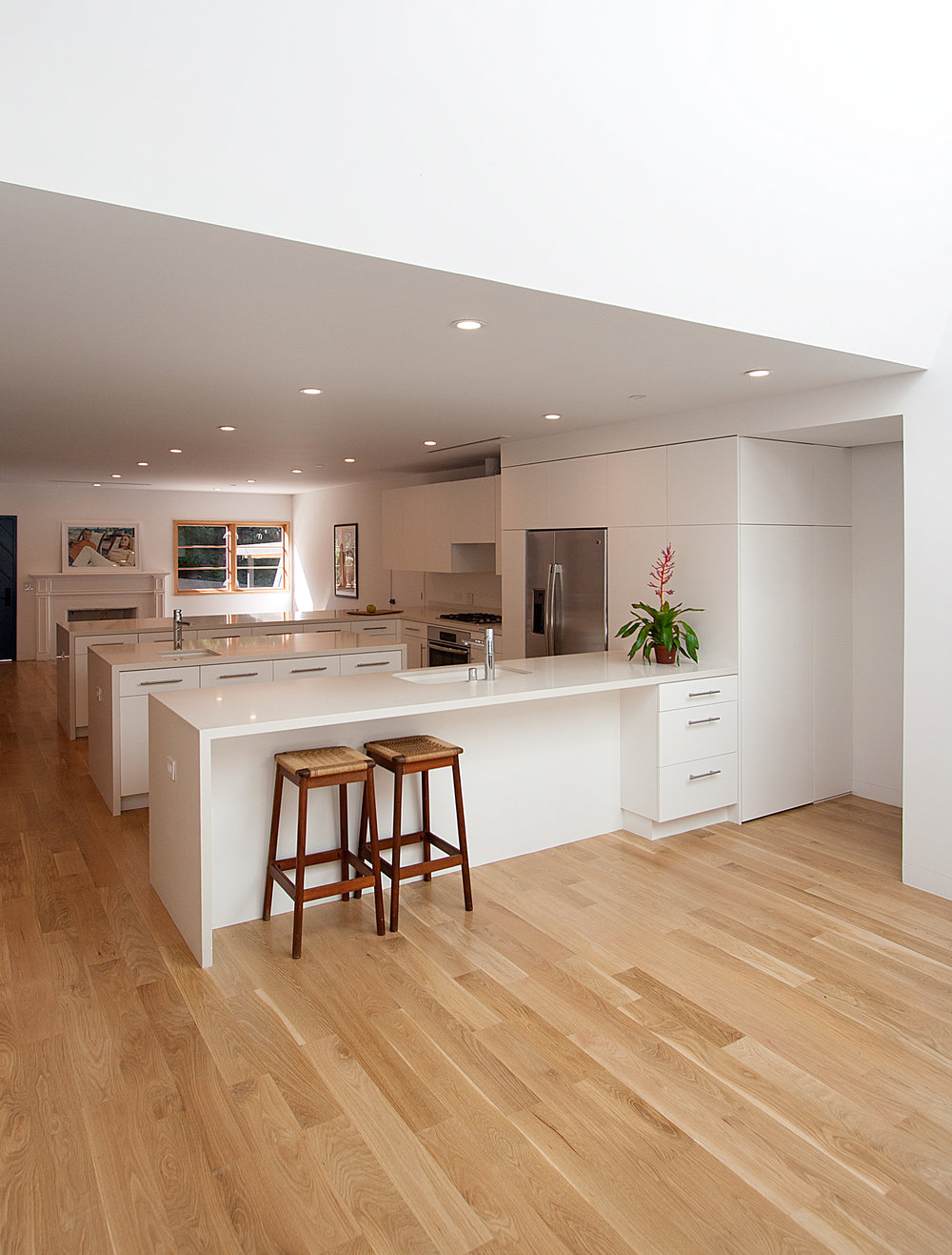"""The kitchen is the """"hub"""" of the home with bar seating, which transforms it into a social space."""