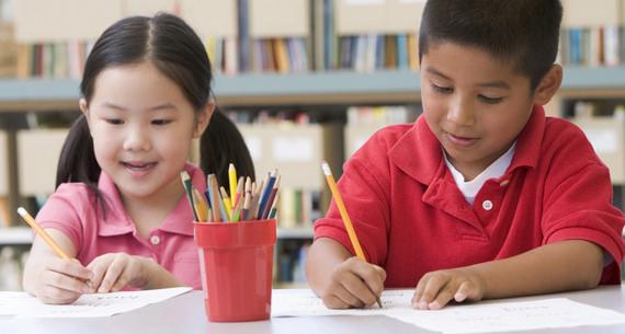 Two kids writing 2.jpg
