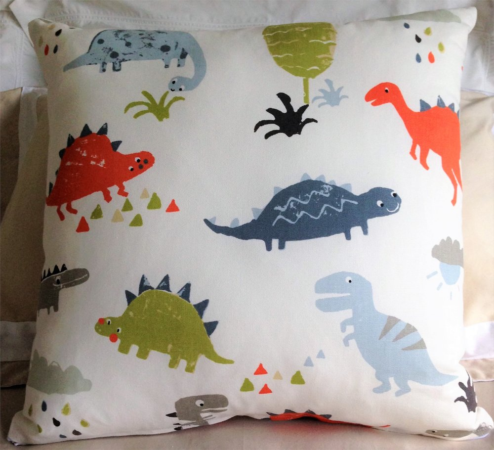 Warwick Fabrics Dinosaur Orange cushion.jpg