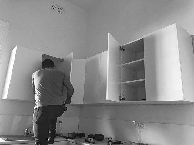 Nick installing our kitchen cupboards at Hawthorn.