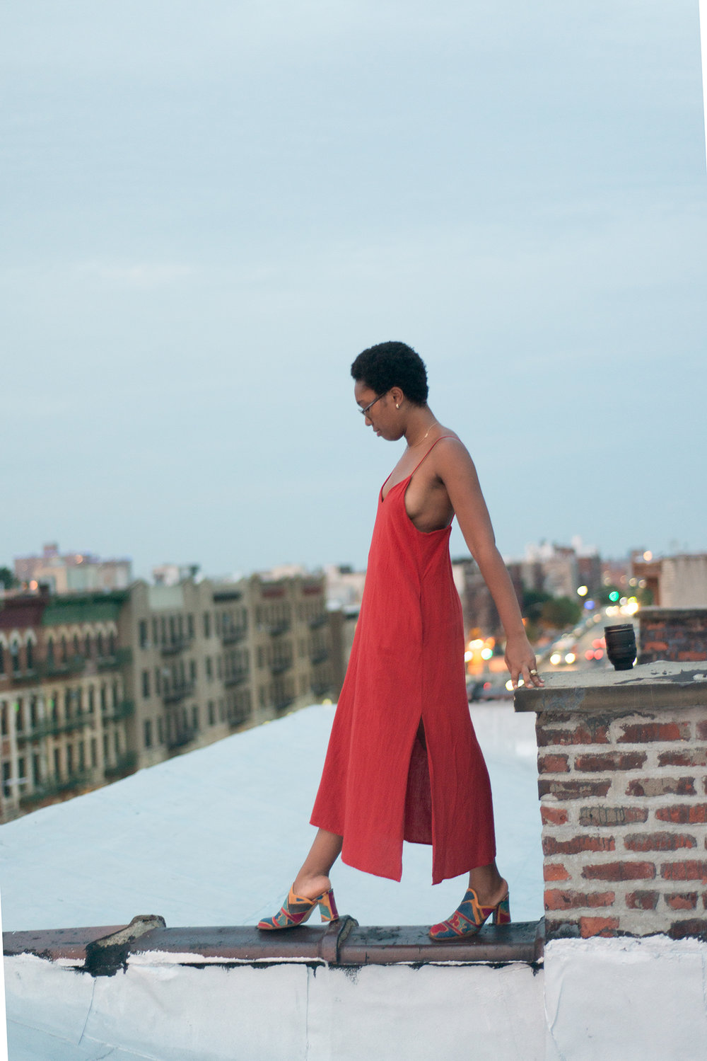 Camille in  The Cala Slip Dress  in red
