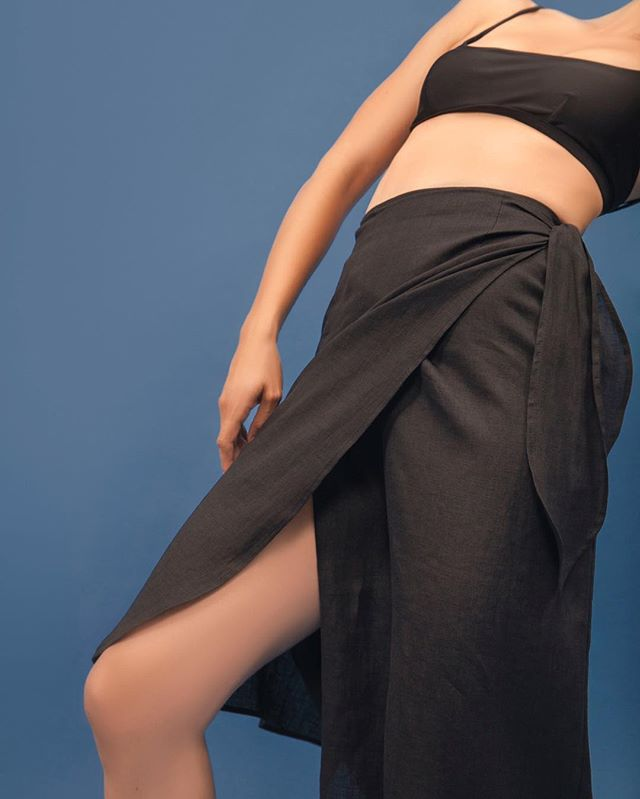 Introducing The Midi Pareo Wrap Skirt, made entirely of luxury deadstock linen. Perfect for the warm summer nights ahead, and layered with knits as we look forward to fall. #parenpar #sustainableclothing #madeinLA