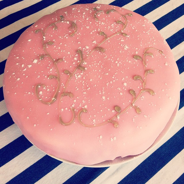 Swedish Princess Cake - Vanilla cake layered with vanilla custard, raspberry conserve, and vanilla whipped cream covered in pink marzipan