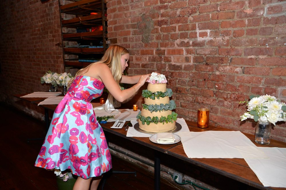 Finishing touches on a cake for a recent Brooklyn wedding.