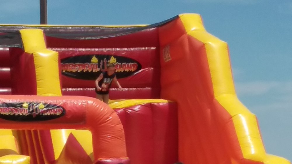The sheer drop from the Daredevil Island bounce house proved too terrifying for many, this brave jumper made the leap.