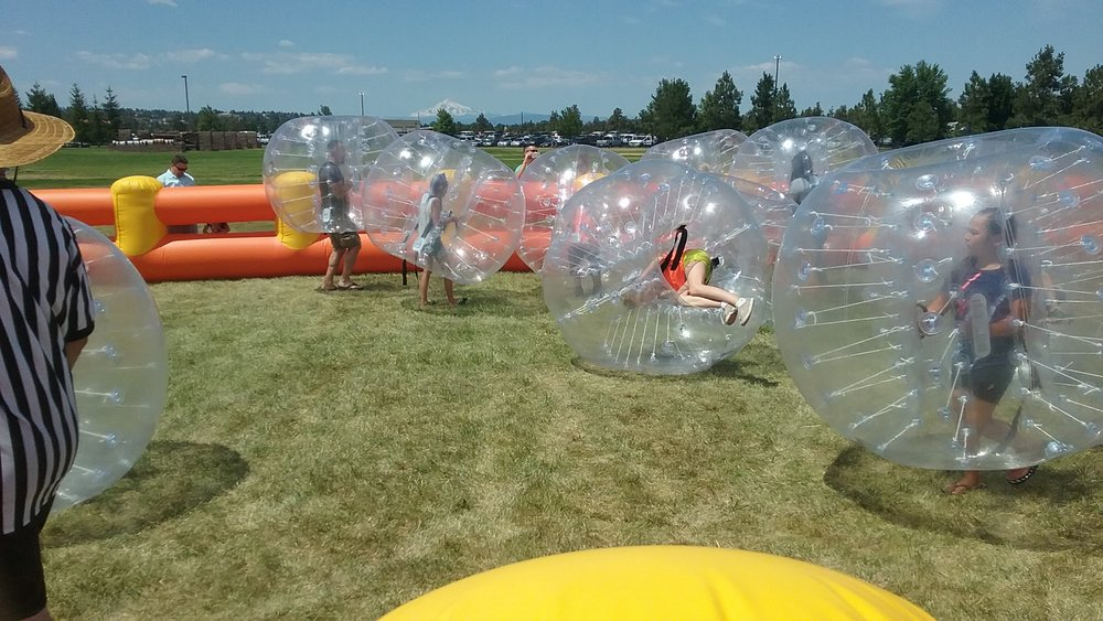 This midfielder tries out an unconventional move to gain a bubble soccer advantage.