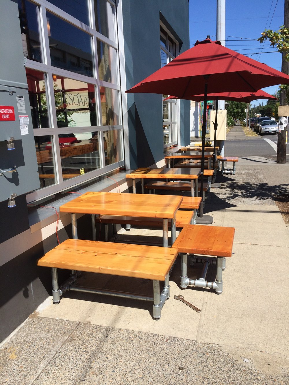 Reclaimed fir and galvanized pipe table and benches.  At Portland tasting room.