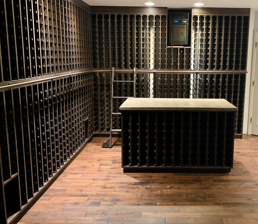 Wine cellar with concrete counter tops.