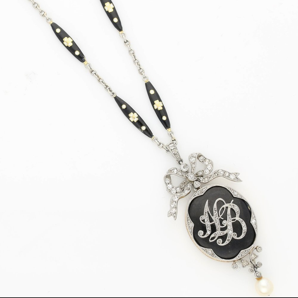 The Victorian mourning pendant with Amy Burton's exact initials
