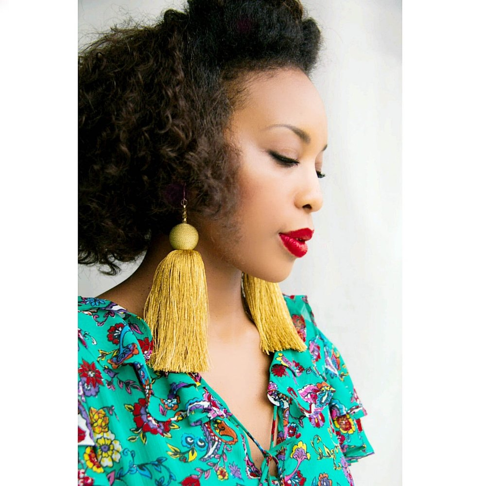 LaToya feels strongest when she is wearing statement earrings and lipstick