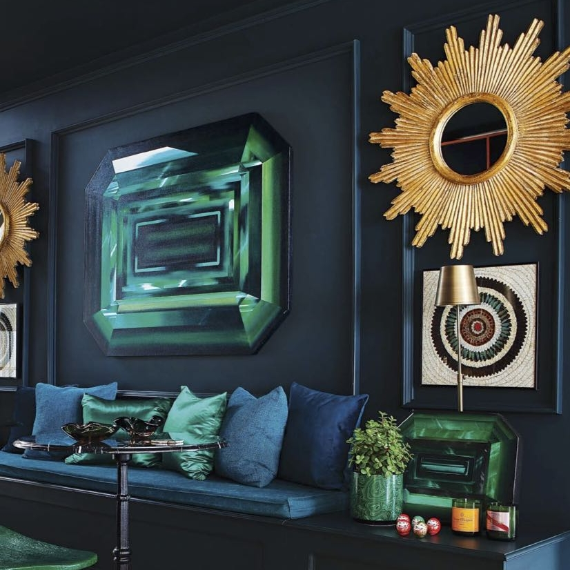 Kurt's Emerald painting is the center of attention in his house