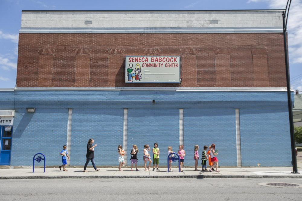 Children from first through third grades wait in line outside the Seneca Babcock Community Center.