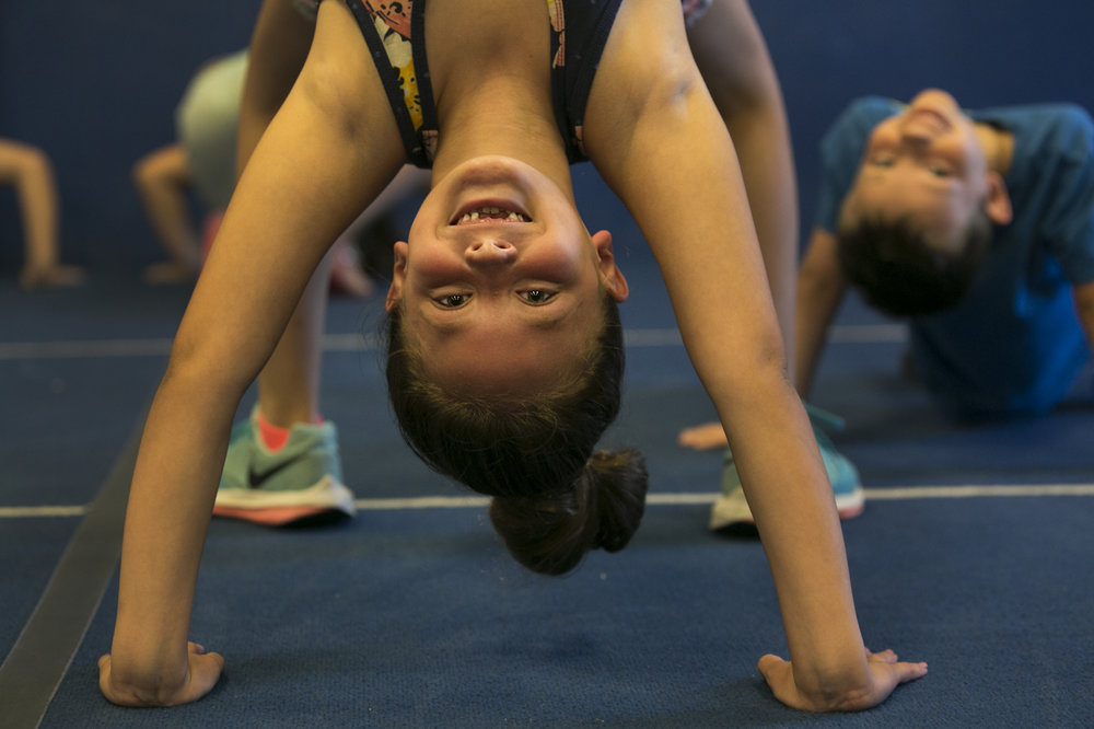 Ilona Bracero shows off her head and handstand.