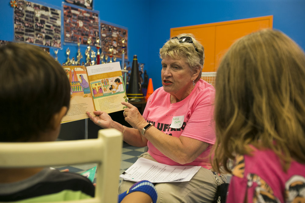 Volunteer Beth Intondi from Georgia reads books for children from first through third grades.