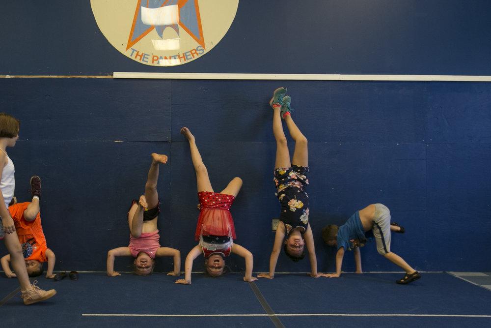Children from first through third grades show off their head and handstands.