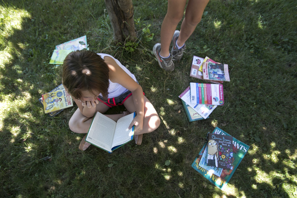 Zoe Jachimiak reads books during the science learning sectionl