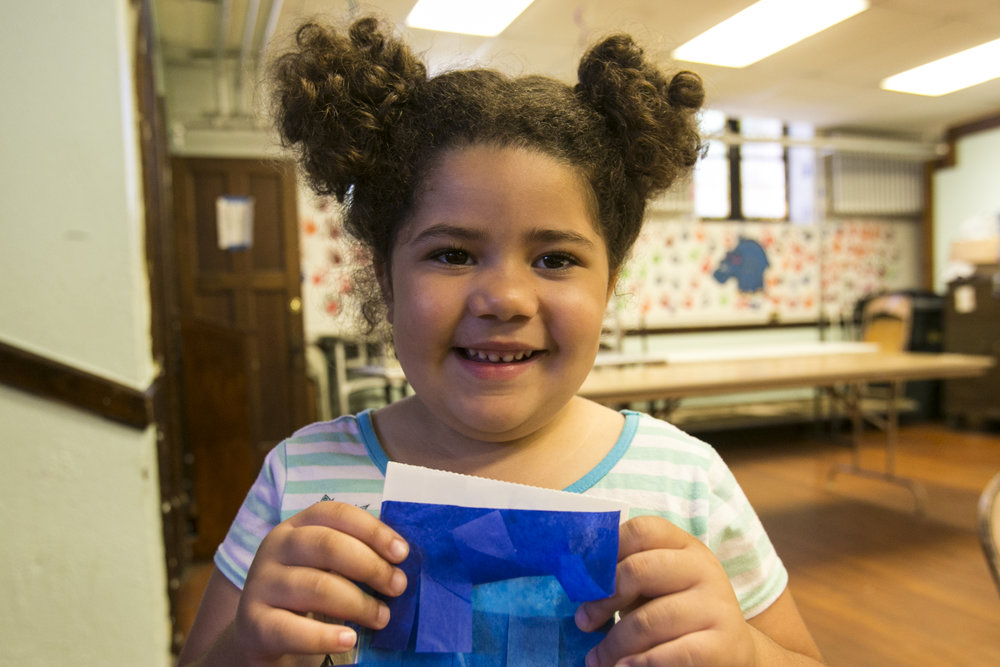 First-grader Phalen Rose Jackson shows off her piñata.