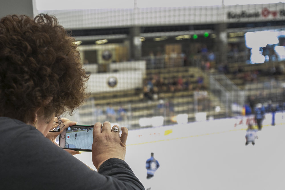 Amy Brand takes a video of the game.