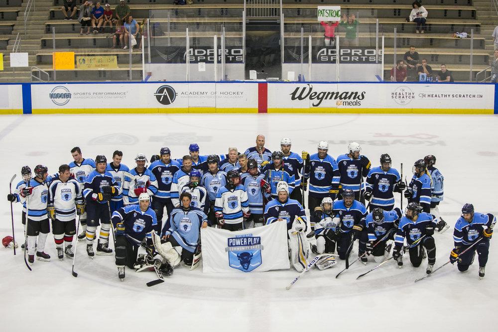 Two teams take group photos.