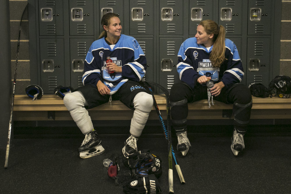 Taylor Accursi and Jacquie Greco rest after the 11 Day Power Play Sunday at HarborCenter. Since last year's Power Play broke a world record with 40 amateur players, the tournament has expanded to about 1,500 players.