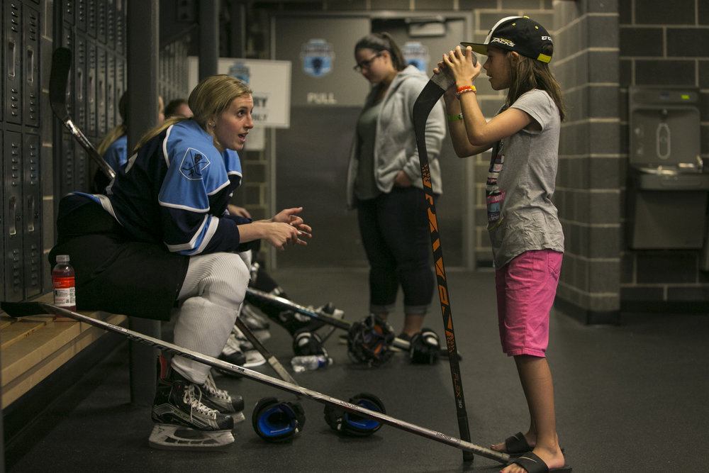 Buffalo Beauts' Maddie Elia talks to a young audience during the break.