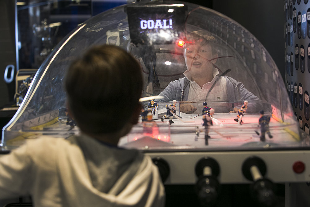 Andrew Barrett, 6, plays table hockey with his 4-year-old brother Bruce Barrett.