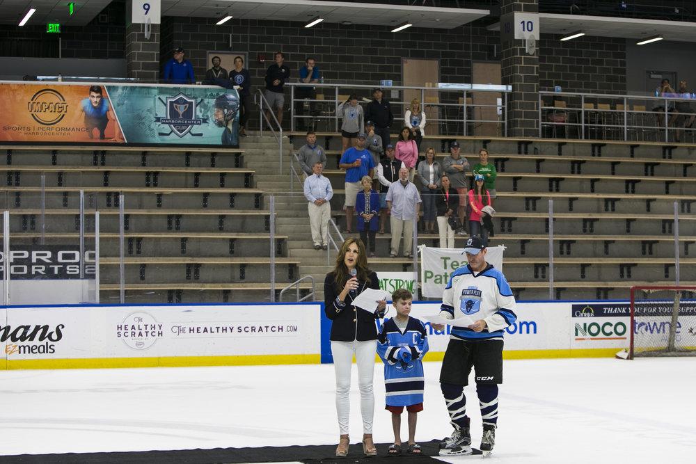 Amy Lesakowski, Emmett Jakubowski and Mike Lesakowski take the ice at the conclusion of the tournament.