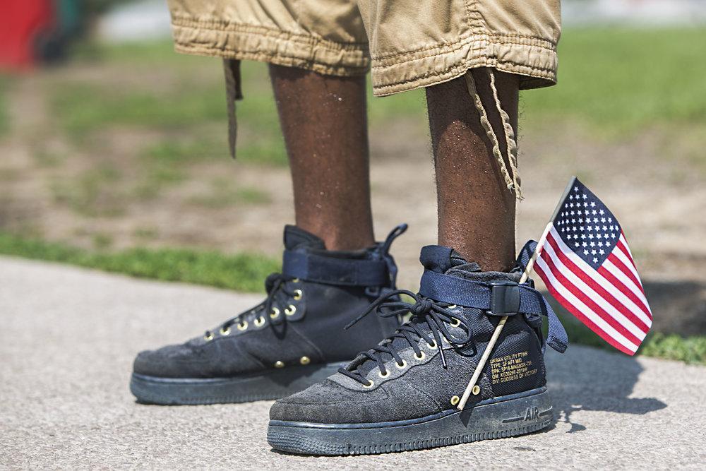 A flag adorns a pair of shoes.
