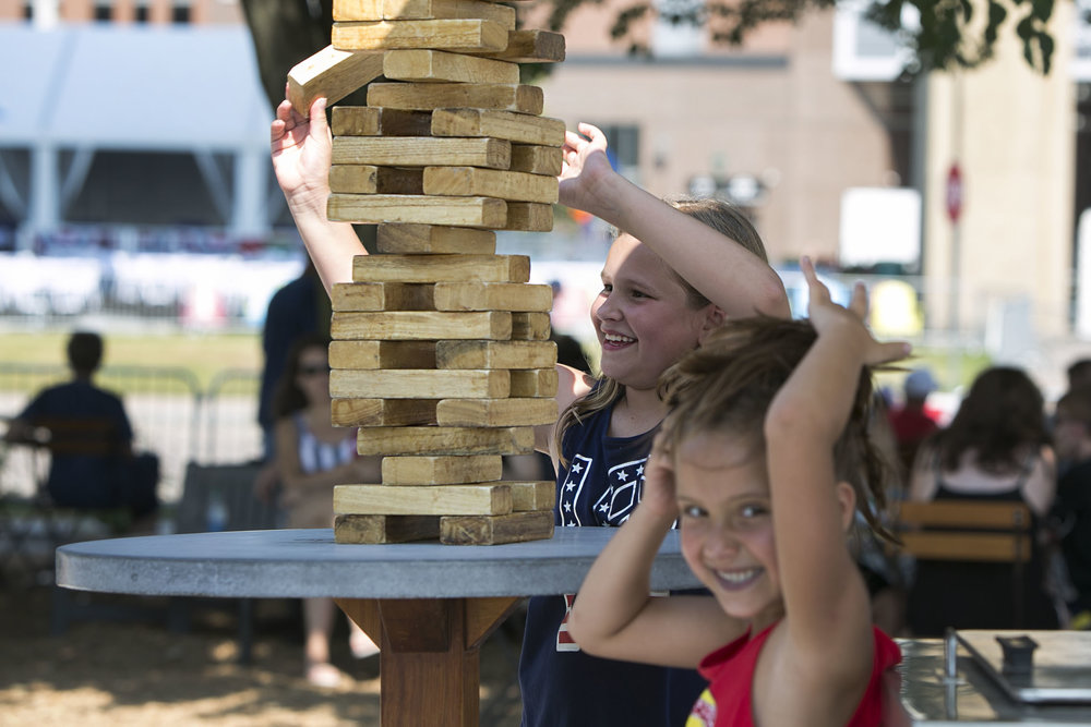 Logan Sticht plays a wooden block puzzle game with her sister Harper.