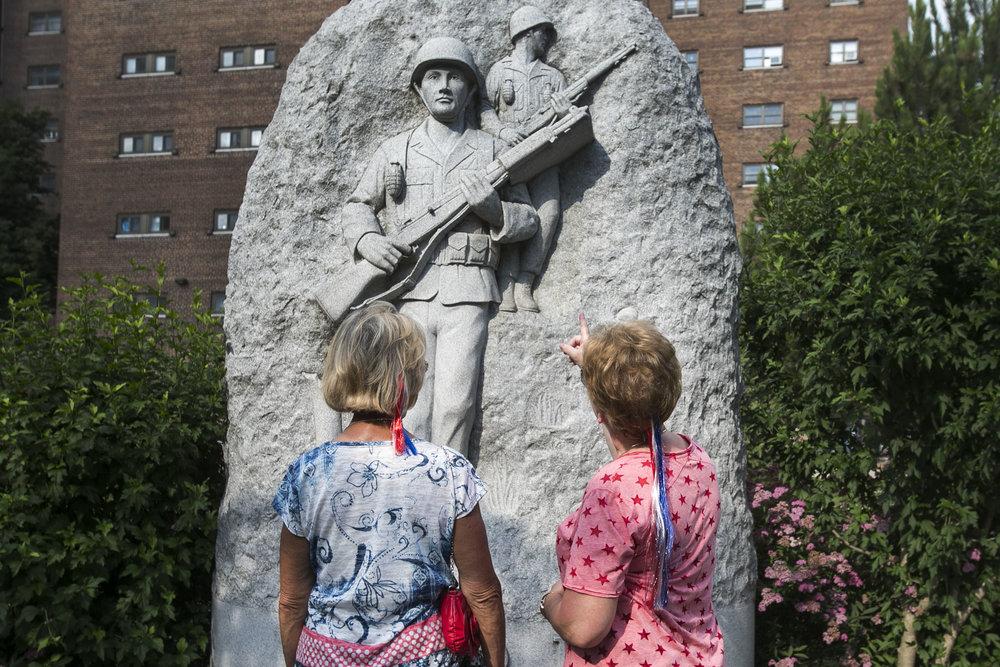 Robin Umatum and her friend Joyce Warren discuss the Korea War sculpture.