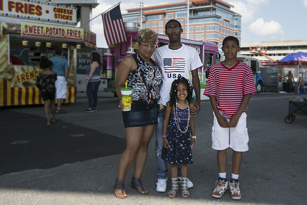 Ivy Sweet, 5; Jordan Sweet, 11; Tyree Sweet, 16; and their mother, Erica Sweet, enjoy celebrate Independence Day at Canalside.
