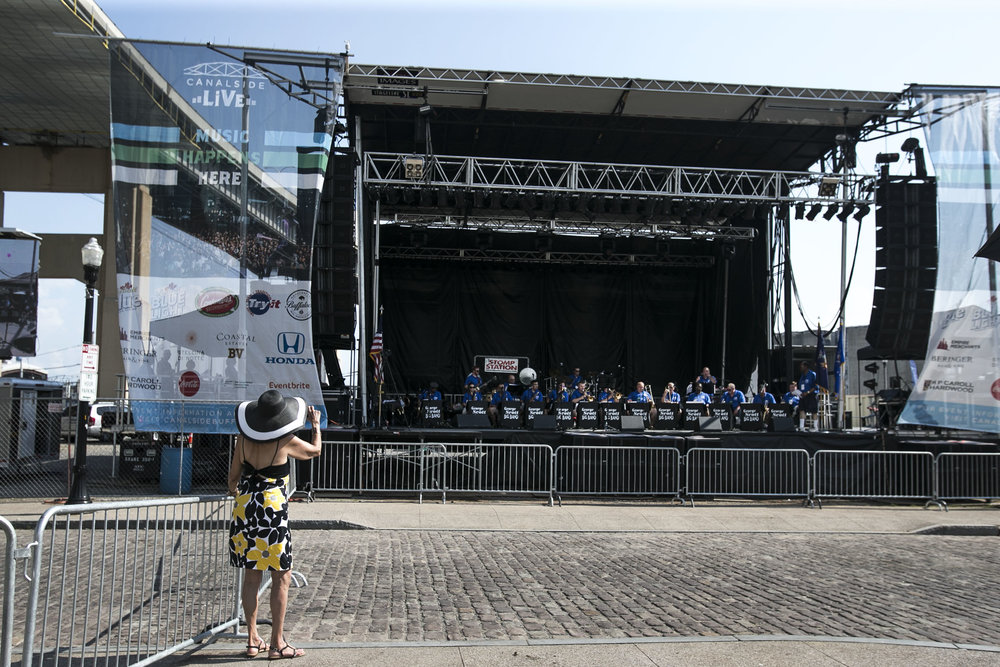 Rosalind Bogner takes photos of her sons-in-law playing music at the stage.