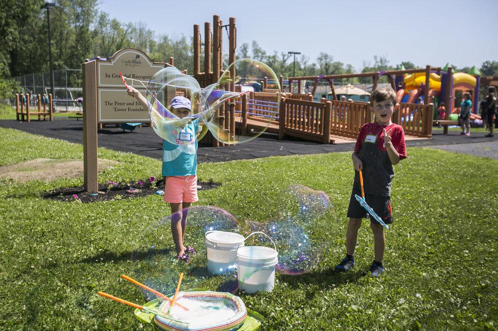Rylee Barden, 7, blows bubbles.