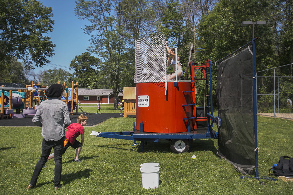 Counselor Emily Szabo gets dunked into a tank.
