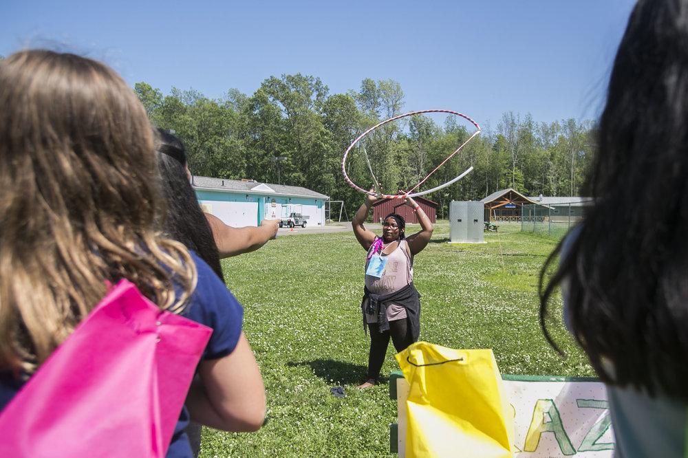 Gantries Hagler, 11, plays human ring toss.