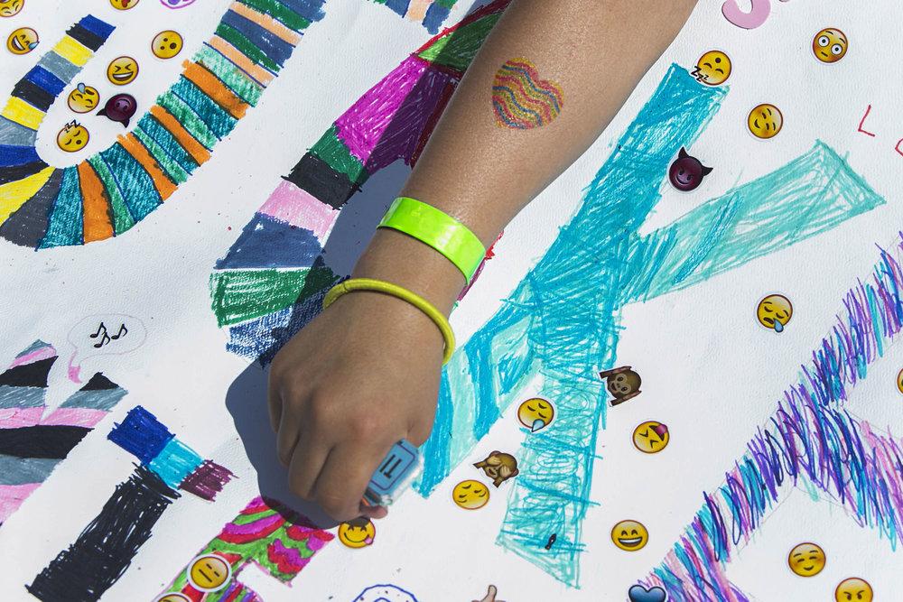 Falastine Fadel, 9, has a heart shape tattoo on her arm.