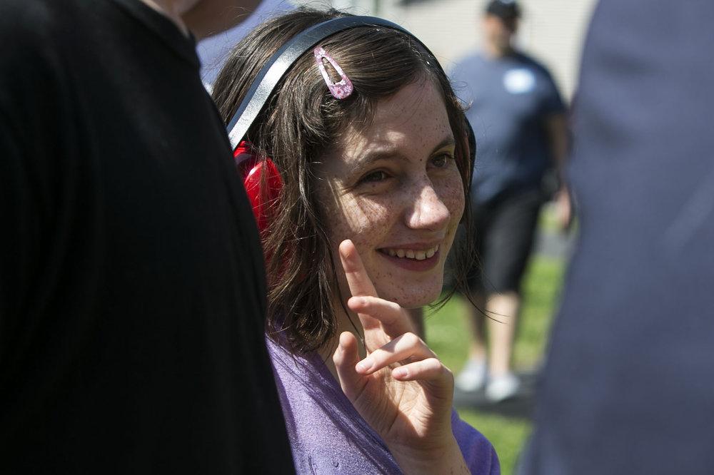 Megan Dobson, 16, smiles at people.