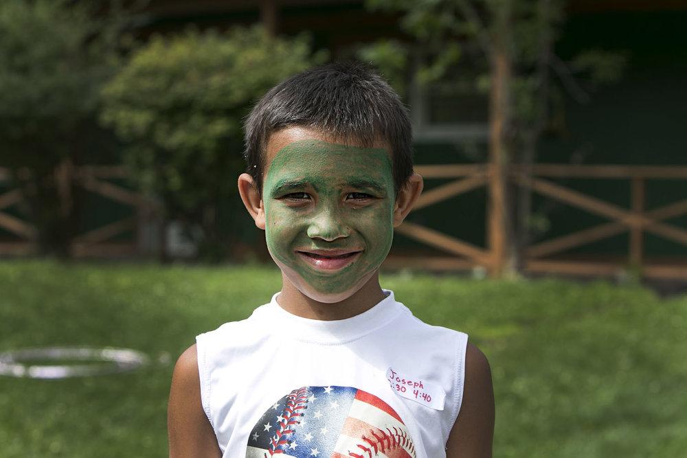 Joseph Cordovan, 9, shows off his face paint.