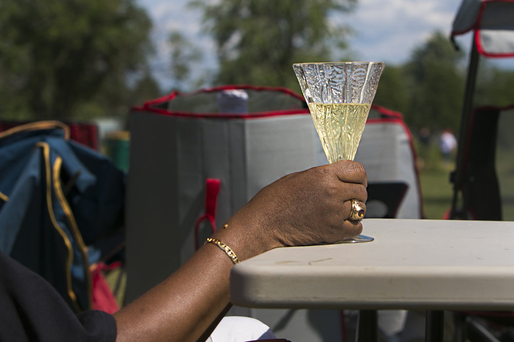 A glass of wine is a must for jazz festival.