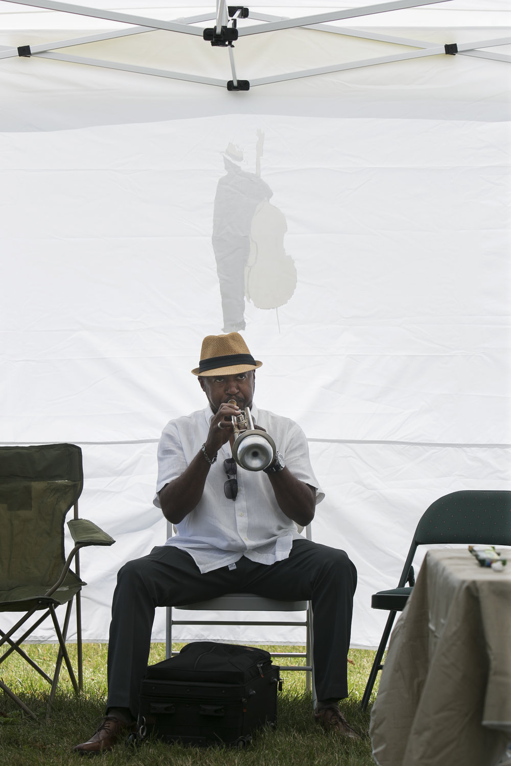 Brian Freeman practices the trumpet before his performance.